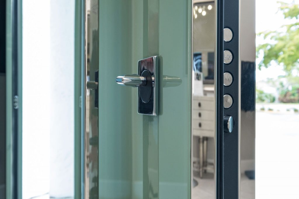 A close-up photo of a home security door with biometric entry technology.