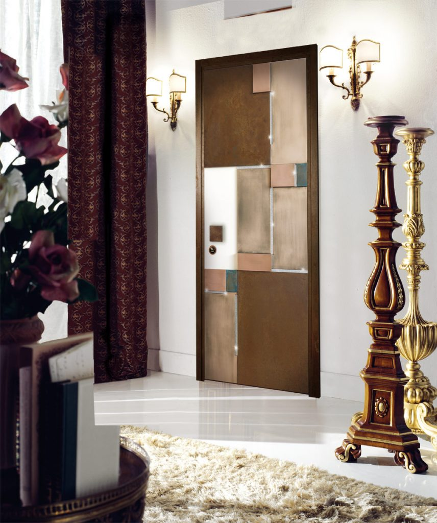 A photo of a bedroom home security door made with precious stones and metals.