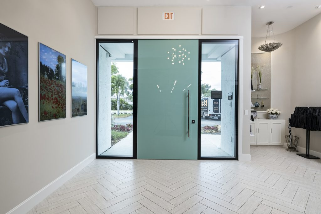 A photo of a custom FBS pivot door at the front entrance of our Florida headquarters.