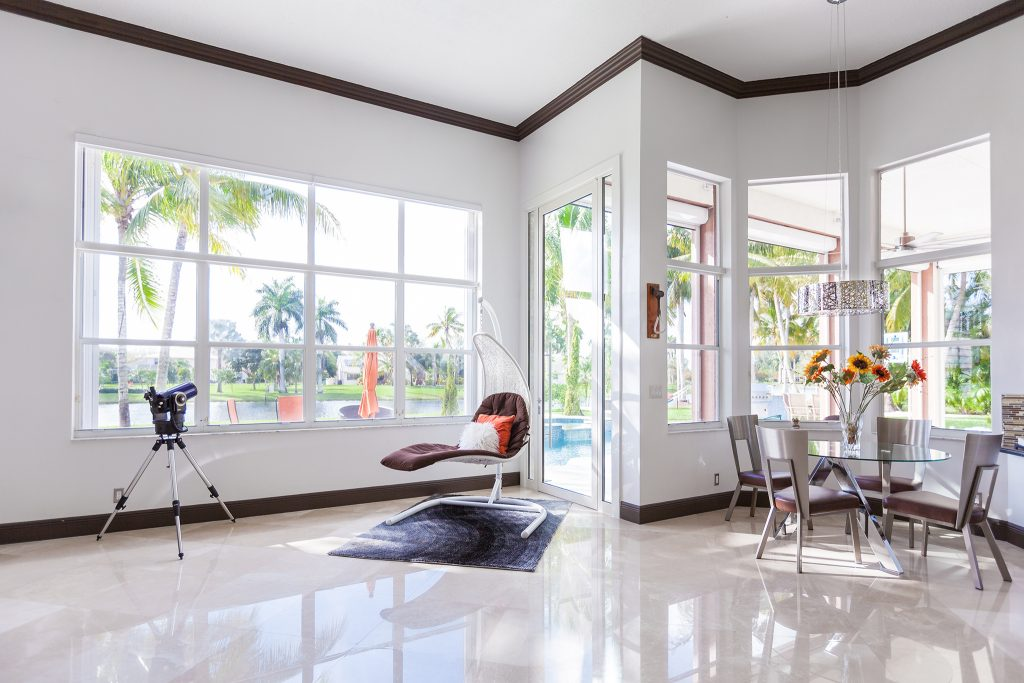 A photo of a bright living room complete with FBS windows.