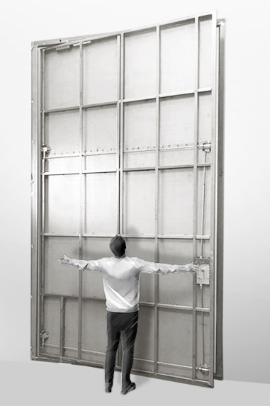 A rendering of an 8-foot by 13-foot steel hurricane certified pivot door with a fully grown man standing in front of it for scale.