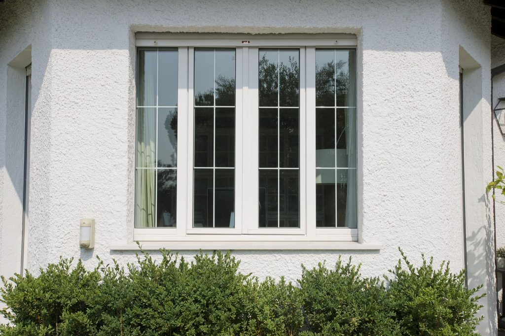 A photo of a hurricane window from the exterior of a house.