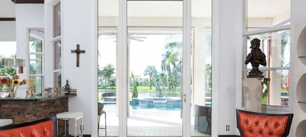 A photo of a beautiful high security glass door leading out to an elegant back patio.