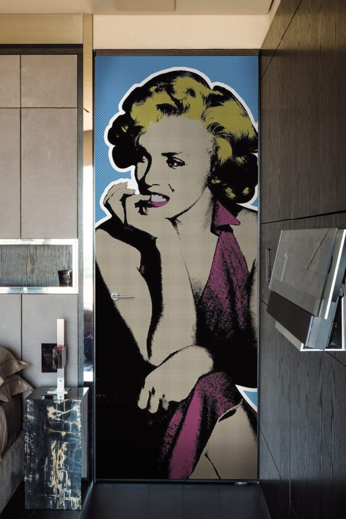 A photo of a bedroom security door designed to feature a portrait of Marilyn Monroe.
