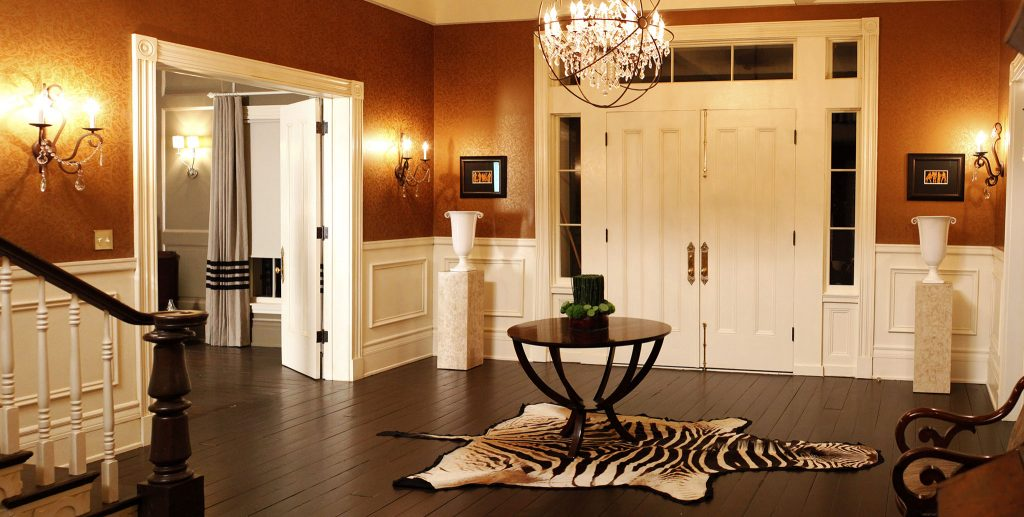 A photo of the interior of the front entrance to a luxury home, complete with a double security door and security windows.
