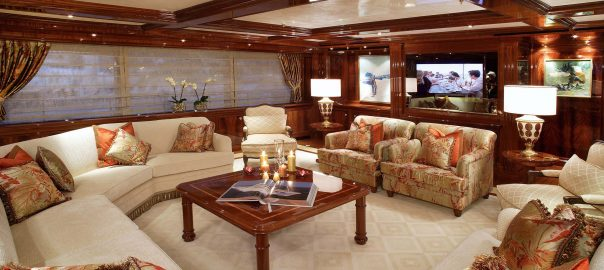 A photo of a large living room with plush couches in a luxury home.