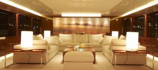A photo of a gorgeous living room in a luxury home surrounded by security windows.