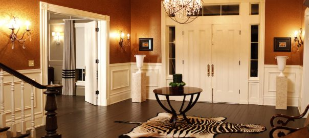 A photo of the front entrance of a luxury home, complete with security doors that do not require wrought iron.