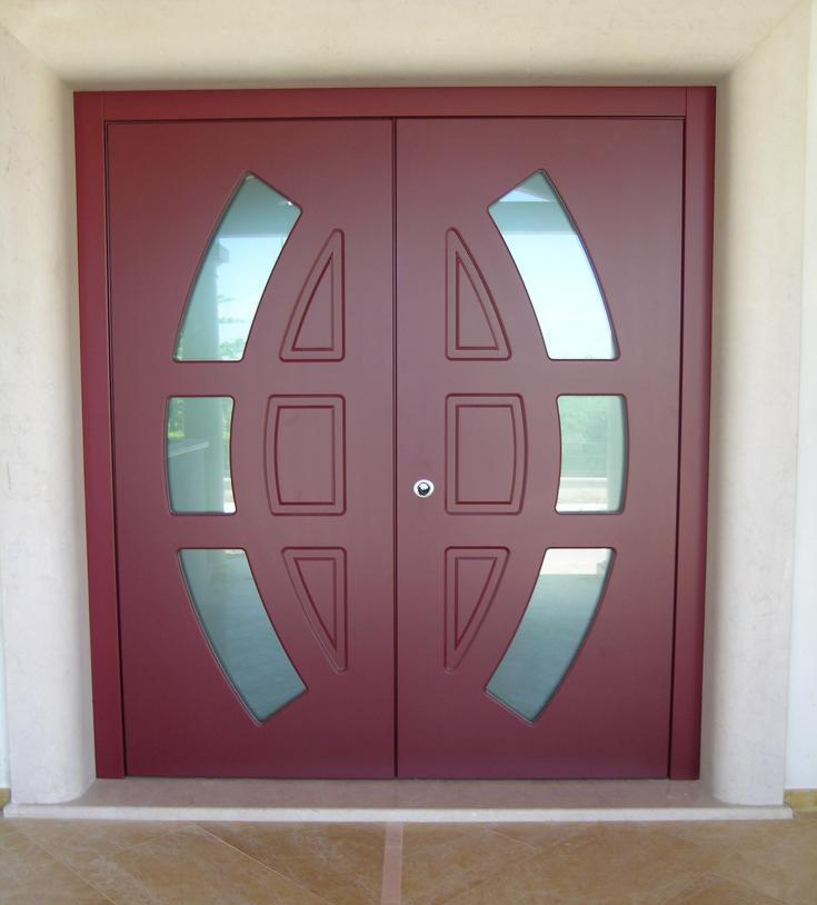 A photo of custom double security doors with frosted glass at the front entrance of a luxury home.