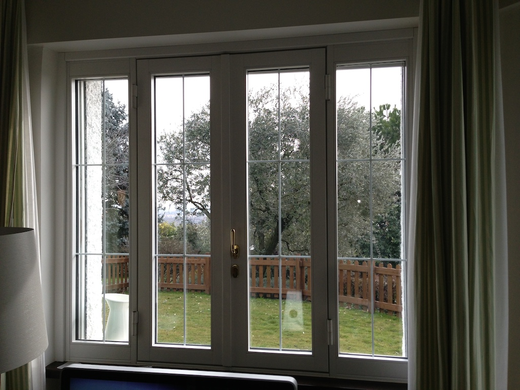 A photo of a residential security window overlooking a fenced in backyard.