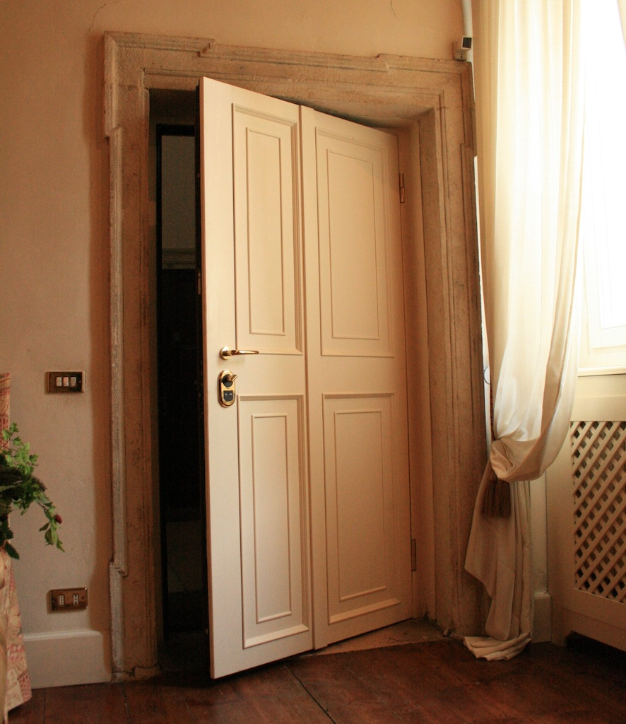A photo of a custom bedroom security door in a luxury home.