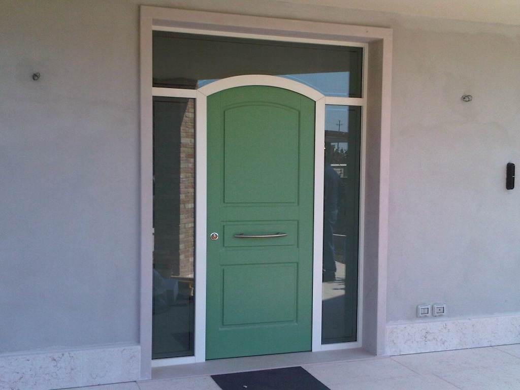 A photo of a custom luxury front door framed by security glass.