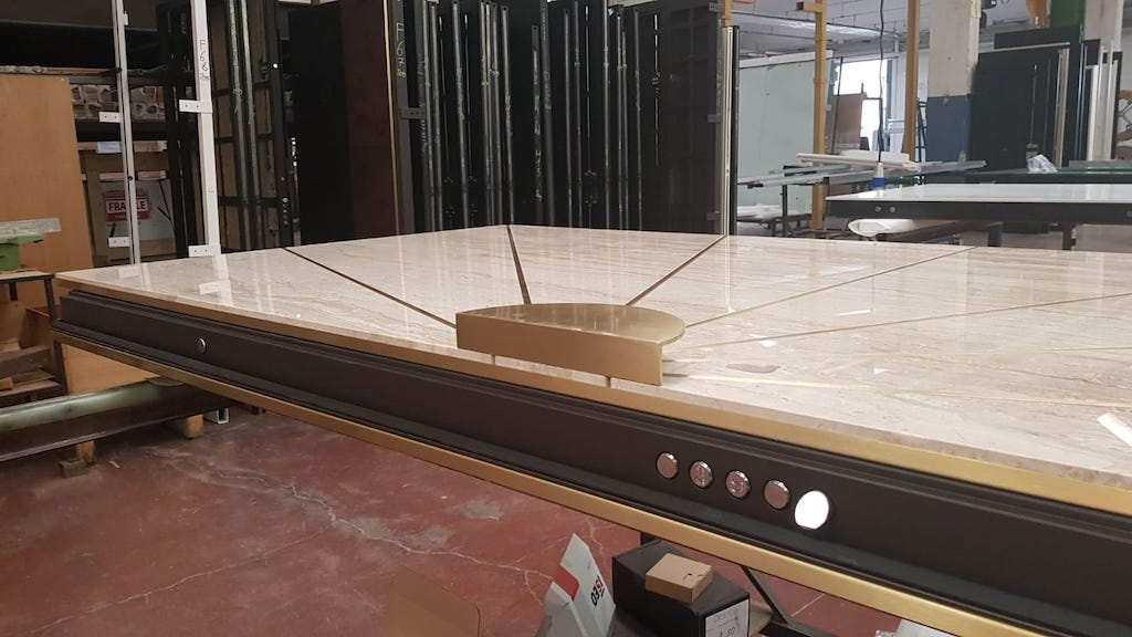 A photo of a custom security door that is in the finishing stages of production.