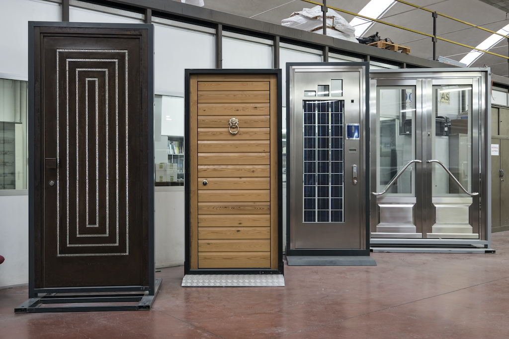 Four custom security doors temporarily installed in frames for testing.