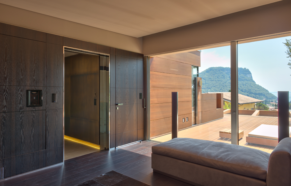 A photo of a frameless security door designed to match the wall.