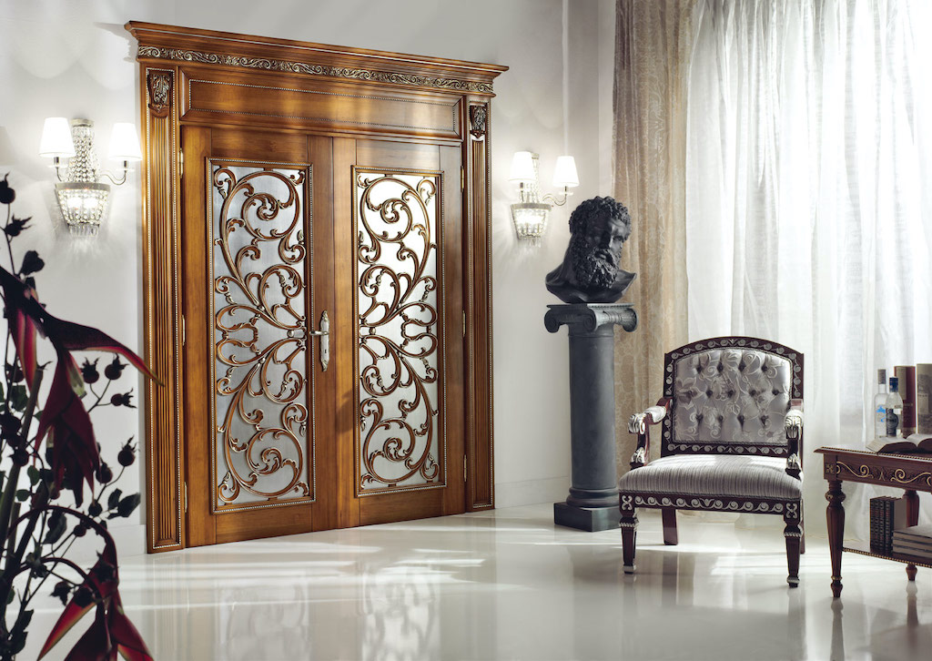 A photo of a set of double bedroom security doors elaborately decorated with real wood and frosted glass.