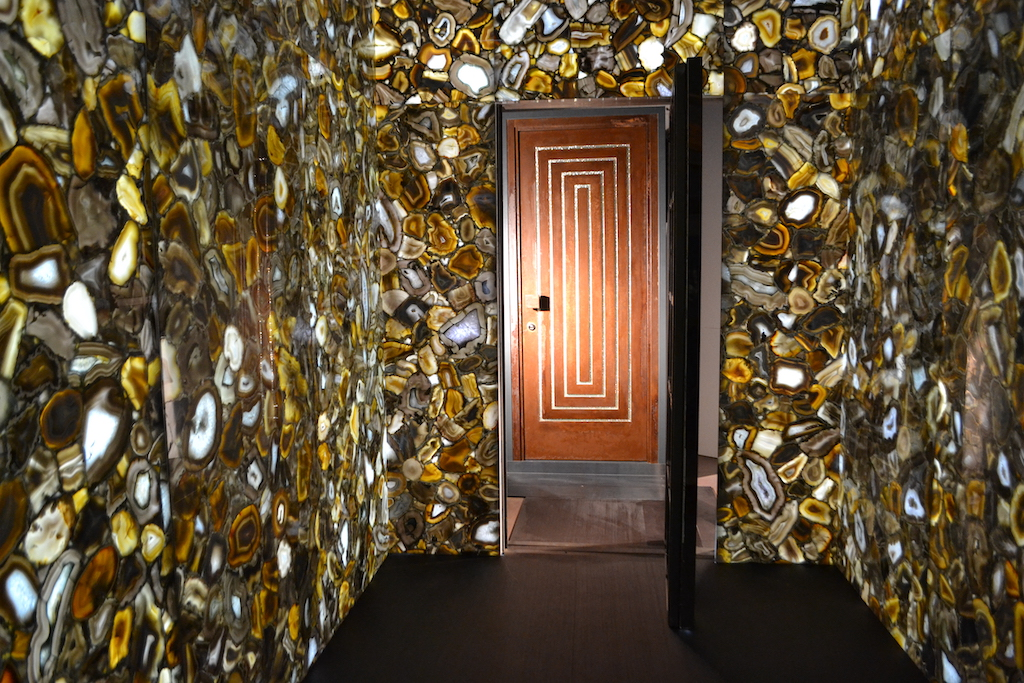 A photo of a very elaborate safe room entrance, complete with a custom security door.