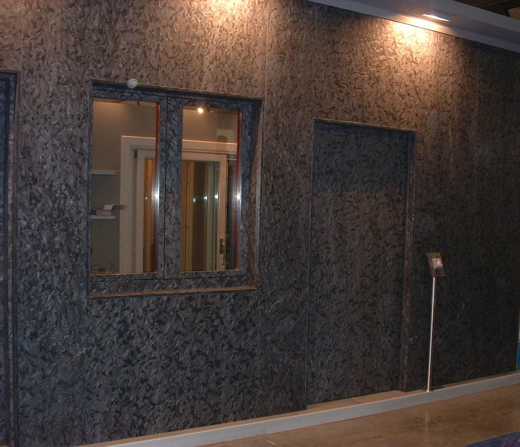 A photo of an indoor storefront featuring a custom security frameless door.